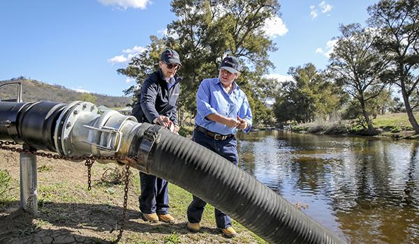 NRAR staff inspecting water pump